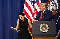 Daria Ortiz, the granddaughter of 92 year old Maria Fuertes, who was raped and murdered in New York, is escorted off stage by United States President Donald J. Trump after delivering remarks to National Border Patrol Council Members in the South Court Auditorium of the White House in Washington D.C., U.S. on Friday, February 14, 2020.<br /> <br /> Credit: Stefani Reynolds / CNP /MediaPunch