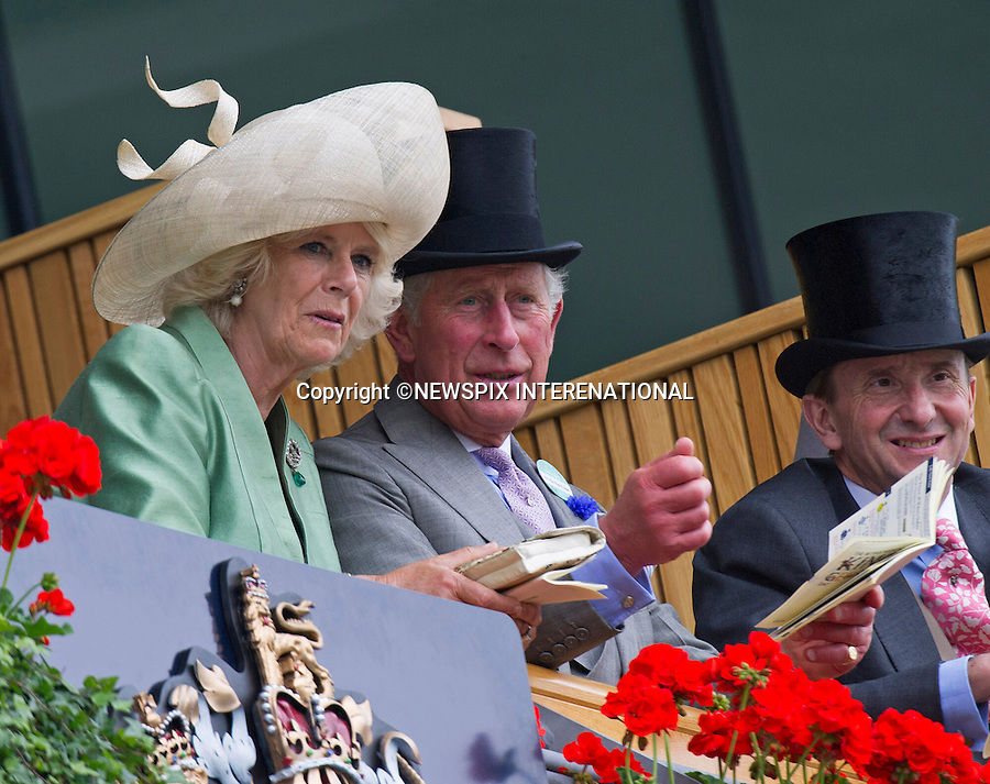 QUEEN, CAMILLA, DUCHESS OF CORNWALL AND PRINCE CHARLES<br /> observe the horses in the parade ring before the race at on the second day of Royal Ascot 2013, Ascot Racecourse, Ascot_19/06/2013<br /> Mandatory Credit Photo: &copy;Francis Dias/NEWSPIX INTERNATIONAL<br /> <br /> **ALL FEES PAYABLE TO: &quot;NEWSPIX INTERNATIONAL&quot;**<br /> <br /> IMMEDIATE CONFIRMATION OF USAGE REQUIRED:<br /> Newspix International, 31 Chinnery Hill, Bishop's Stortford, ENGLAND CM23 3PS<br /> Tel:+441279 324672  ; Fax: +441279656877<br /> Mobile:  07775681153<br /> e-mail: info@newspixinternational.co.uk