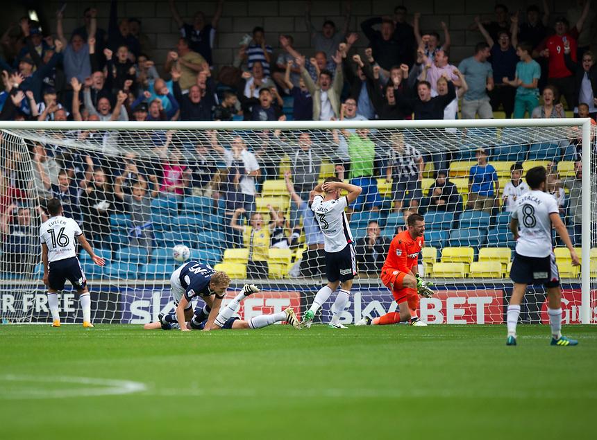 Millwall's George Saville scores the opening goal leaving Bolton Wanderers' goalkeeper Mark Howard dejected<br /> <br /> Photographer Ashley Western/CameraSport<br /> <br /> The EFL Sky Bet Championship - Millwall v Bolton Wanderers - Saturday August 12th 2017 - The Den - London<br /> <br /> World Copyright &not;&copy; 2017 CameraSport. All rights reserved. 43 Linden Ave. Countesthorpe. Leicester. England. LE8 5PG - Tel: +44 (0) 116 277 4147 - admin@camerasport.com - www.camerasport.com