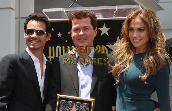 MARC ANTHONY, SIMON FULLER & JENNIFER LOPEZ.Simon Fuller Hollywood Walk Of Fame Induction Ceremony  Held On Hollywood Blvd., Hollywood, California, USA..May 23rd, 2011.half length black suit plaque star trousers sunglasses shades married husband wife green teal dress glasses goatee facial hair .CAP/ADM/KB.©Kevan Brooks/AdMedia/Capital Pictures.