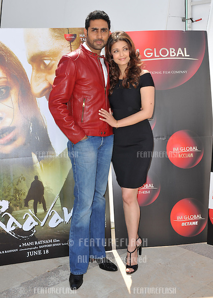 "Aishwarya Rai Bachchan & husband Abhishek Bachchan at photocall for their new movie ""Raavan"" at the 63rd Festival de Cannes..May 17, 2010  Cannes, France.Picture: Paul Smith / Featureflash"
