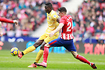 Atletico de Madrid's Jose Maria Gimenez (r) and Girona FC's Michael Olunga during La Liga match. January 20,2018. (ALTERPHOTOS/Acero)