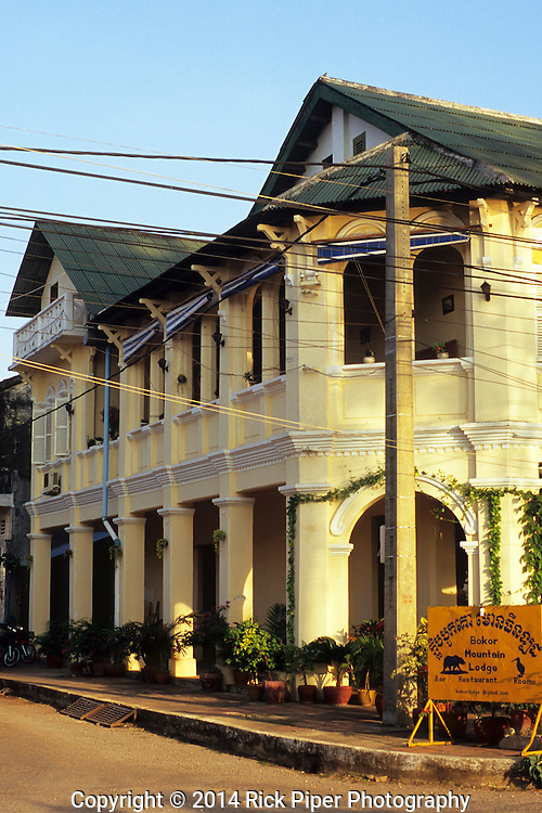 Bokor Mountain Lodge hotel and restaurant in restored old French colonial building on the riverfront road, Kampot, Cambodia.