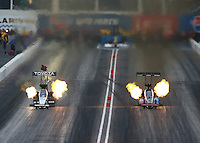 Feb 20, 2015; Chandler, AZ, USA; NHRA top fuel driver Antron Brown (left) races alongside J.R. Todd during qualifying for the Carquest Nationals at Wild Horse Pass Motorsports Park. Mandatory Credit: Mark J. Rebilas-