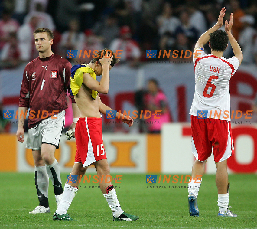 Gelsenkirchen 9/6/2006 World Cup 2006.Poland Ecuador - Polonia Ecuador 0-2.Photo Andrea Staccioli Insidefoto.Disappointment of Poland players Artur Boruc, Ebi Smolarek and Jacek Bak at the end of the match.La delusione dei giocatori Boruc Smolarek e Bak alla fine della partita