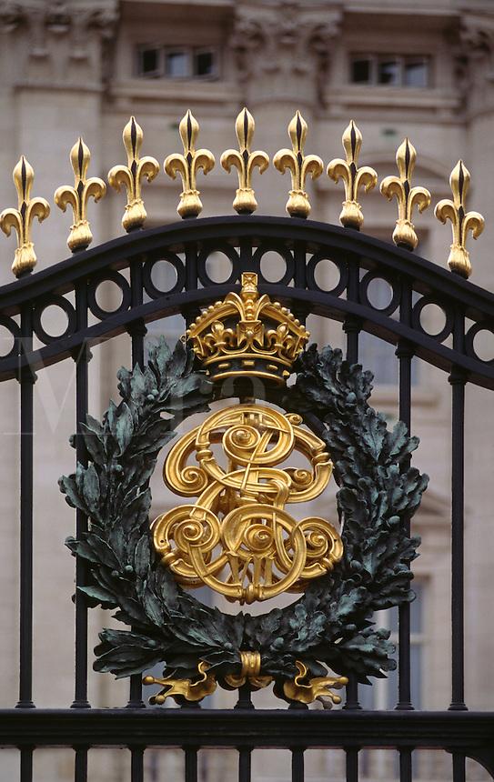ROYAL EMBLEM on the gate surrounding BUCKINGHAM PALACE - LONDON, ENGLAND.