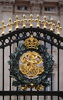 ROYAL EMBLEM on the gate surrounding BUCKINGHAM PALACE - LONDON, ENGLAND.