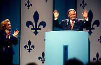 File Photo, 1995, Montreal, Quebec, Canada<br /> <br /> Parizeau's wife  Lisette Lapointe (L) applaud while<br /> Jacques Parizeau, Quebec Premier and leader of the Parti Quebecois, get on stage  to deliver his defeat speech,  on  the 1995 referendum night, in Montreal, Canada, .<br /> <br /> Parizeau was widly blamed even in his own paryty, for blaming the defeat on `` money and the ethnic vote ``, he was replaced shortly after, by Lucien Bouchard.<br />  <br /> Mandatory Credit: Photo by Pierre Roussel- Images Distribution. (©) Copyright 1994 by Pierre Roussel <br /> <br /> NOTE: Nikon LS-2000 scan from 35mm slide<br />  - Mulcair is now (2011) with the New Democratic Party (of Canada).