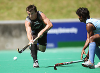 NZ's Lloyd Stephenson passes during the international hockey match between the New Zealand Black Sticks and India at National Hockey Stadium, Wellington, New Zealand on Saturday, 20 February 2009. Photo: Dave Lintott / lintottphoto.co.nz