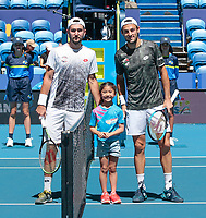 5th January 2020; RAC Arena, Perth, Western Australia; ATP Cup Australia, Perth, Day 3; Italy versus Norway; Stefano Travaglia of Italy and Viktor Durasovic of Norway pose for a photograph with toin coss girl Isabelle - Editorial Use
