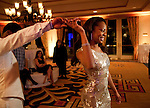 Wearing her second dress change, Richards leads Ross into the reception. Olympic gold medalist, Sanya Richards, and New York Giants cornerback, Aaron Ross, wed at the Hyde Park Baptist in Austin, Texas on Friday, February 26, 2010...