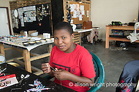 Africa, Swaziland, Malkerns. Nest organization artisan project partnering with Quazi Design, co-founded in 2009 by Doron, a UK designer & Flotsam, local magazine distributors, making jewely from recycled paper.