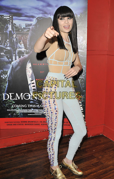 Jessie J (Jessica Ellen Cornish).UK film premiere of 'Demons Never Die' held at the Odeon West End - Arrivals.London, England..October 10th, 2011.full length nude gold shoes blue jumpsuit catsuit beige beads beaded hand finger pointing side mouth open.CAP/CAN.©Can Nguyen/Capital Pictures.