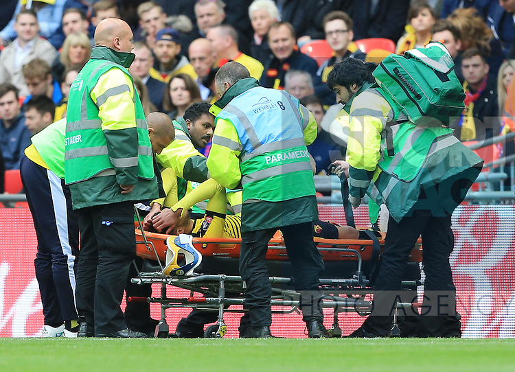 Watford's Etienne Capoue gets stretchered off during the Emirates FA Cup, Semi-Final match at Wembley Stadium, London.  Photo credit should read: David Klein/Sportimage