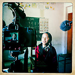 Girl being interviewed at the Shree Bayrayoginee Secondary School, sponsored by 10x10 partner Room to Read, in Nepal.