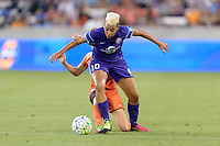 Lianne Sanderson (10) of the Orlando Pride battles Morgan Brian (6) of the Houston Dash for the ball on Friday, May 20, 2016 at BBVA Compass Stadium in Houston Texas. The Orlando Pride defeated the Houston Dash 1-0.