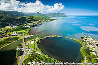 An aerial perspective of a Hawaiian fishpond near Kane'ohe, with Chinaman's Hat and Kualoa Valley in the distance on O'ahu.