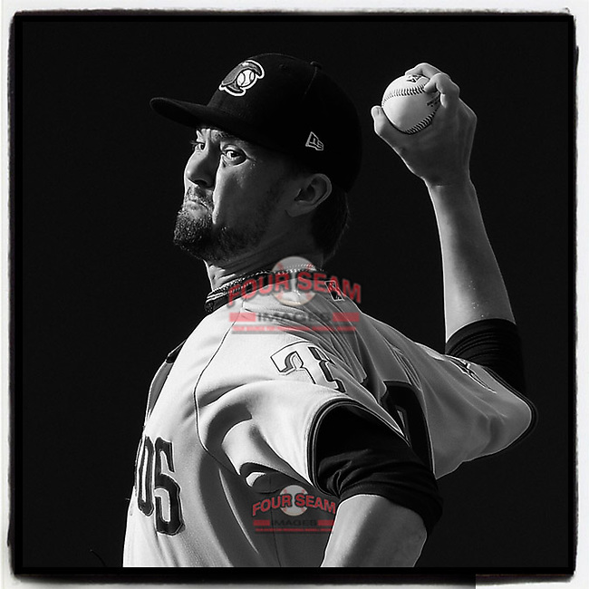 Pitcher Derek Heffel (30) of the Hickory Crawdads pitches into the sun in Game 1 of a doubleheader against the Greenville Drive on Wednesday, July 25, 2018, at Fluor Field at the West End in Greenville, South Carolina. Greenville won, 4-1. (Tom Priddy/Four Seam Images) #MiLB