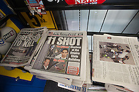 New York daily newspapers on Saturday, August 25, 2012 report on the previous days shooting of Steven Ercolino by Jeffrey Johnson. Johnson, who held a grudge against Ercolino, was subsequently shot and killed by police outside the Empire State Building with 11 innocent bystanders injured by police bullets. (© Richard B. Levine)