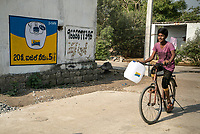 A young boy rides on his bicycle to the iJal station in Ambedkar Nagar in Medak, Telangana, India.