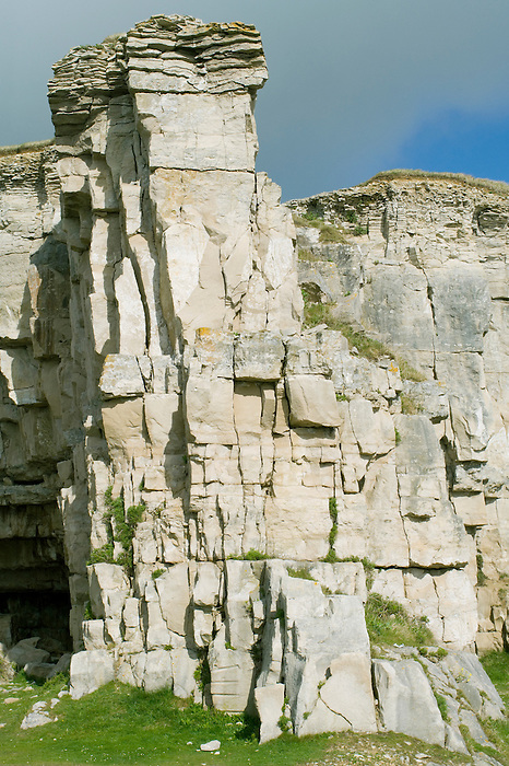 Limestone rock face at Winspit Quarry in Dorset- a popular climbing area.