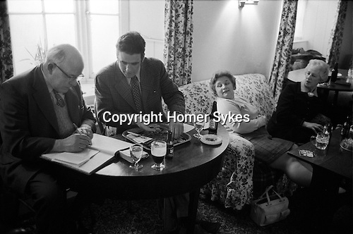 Stowell Court and Candle Auction, Tatworth, Somerset, England 1975. Auction takes place in lounge bar of the Poppe Inn. <br /> <br />  My ref 10/954/1975