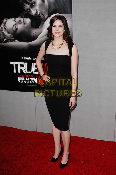 "MARIANA KLAVENO.arriving at the Los Angeles premiere of Season 2 of the HBO series ""True Blood"" on the backlot at Paramount Pictures Studio in Hollywood, California, USA, June 9th 2009..full length black dress hand on hip shoes .CAP/ROT.©Lee Roth/Roth Stock/Capital Pictures."