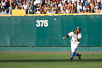UCLA RF Chris Giovinazzo catches a ball in Game One of the NCAA Division One Men's College World Series Finals on June 28th, 2010 at Johnny Rosenblatt Stadium in Omaha, Nebraska.  (Photo by Andrew Woolley / Four Seam Images)