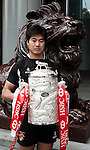 International rugby player Zhang Zhiqang of China from the Top 5 nations competing in this year's HSBC Asian 5 Nations poses with the tournament trophy near the iconic HSBC lion on January 19, 2011 in Hong Kong, China. Japan is the defending champions. Photo by Victor Fraile