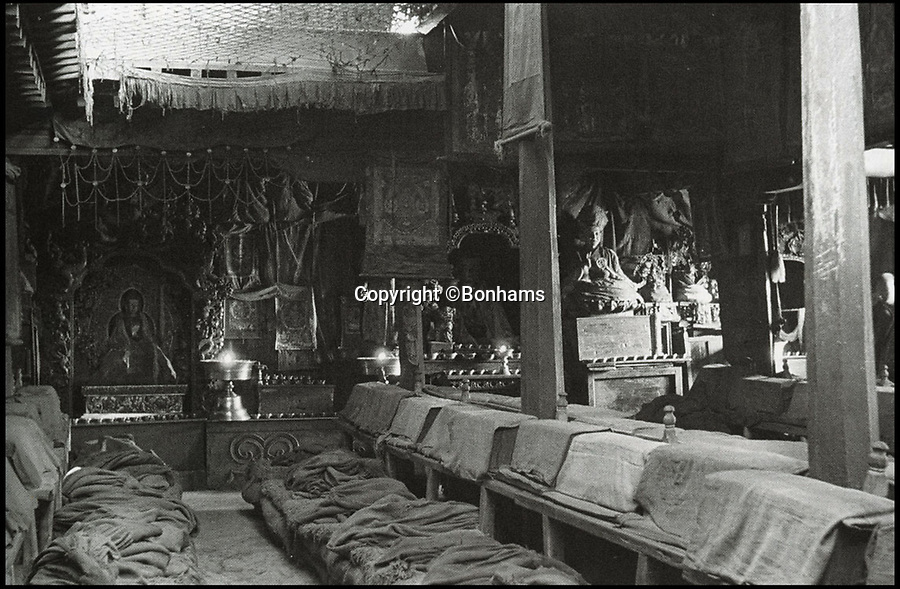 BNPS.co.uk (01202 558833)Pic: Bonhams/BNPS<br /> <br /> The lamp inside Tashilhunpo Monastery in Tibet in 1939.<br /> <br /> Spread the word - Unique Tibetan butter lamp expected to sell for a whopping £2million.<br /> <br /> The enormous bronze lamp, weighing a staggering 53 stone, was made for a Chinese emperor Yingzong 560 years ago.<br /> <br /> The lamp, which stands at 3ft 4ins tall, was one of several commissioned by the Ming Dynasty Emperor, who ruled from 1450 to 1457.<br /> <br /> His reign was fairly controversial and his legitimacy was questioned so he invited Buddhist Tibetan leaders to his court and gave them magnificent gifts to curry favour.<br /> <br /> The lamp was used to light the Tasilhunpo monastry in Shigatse in Tibet using yak butter as fuel.<br /> <br /> The religious relic is now being sold by Bonhams in London on May 17th.