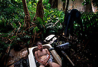 "Dave Johnson came to Palmyra to set up communication equipment.  He takes a daily bath in gerry rigged by yachties to an old military cachement basin.  This tub was used by many characters including the murderer from best selling book ""And the Sea Will Tell.""The largest purchase to date for the Nature Conservancy is the Palmyra an atoll situated about 300 miles north of the equator.  Palmyra has five times as many coral species as the Florida Keys and three times as many as Hawaii.  It is home to the world's largest invertebrate, the rare coconut crab, and a population of red-footed booby birds second only to that of the Galapagos.  It is the last marine wilderness area left in the U.S. tropics and is home to the last remaining stands of Pisonia grandis beach forest in the world.  Palmyra was a US Navy supply base in World War II, the site of a proposed nuclear waste dump, an unsuccessful coconut plantation and of various development schemes.  Palmyra is most famous for the 1974 slaying  of a married couple which became the subject of the best-selling book ""And the Sea Will Tell,"" by Vincent Bugliosi."