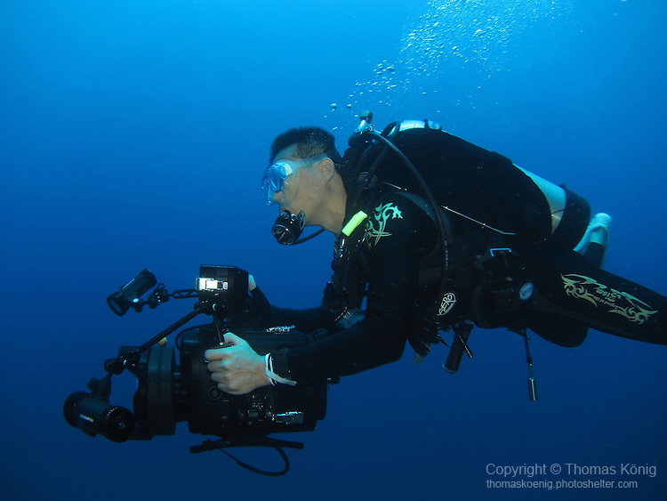 Qixingyan ('Seven Star Rock'), Taiwan -- Lugging around some serious video equipment under water.