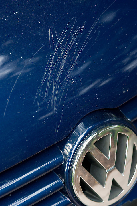 """On July 30, 2011, the signature work of """"rock"""" artist Holden Miller, 4, was discovered as a series of seven frenetic scratches etched with rocks into the paint of multiple panels of a blue VW Jetta, the car belonging to the boy's father, Jeff Miller. The Miller/Stute family lives in Madison, Wis., and all are doing their best to remain calm. Holden continues to ask his father, """"You still love me, right?"""" Yes, I still love the boy."""