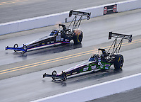 Sept. 15, 2012; Concord, NC, USA: NHRA top fuel dragster driver Larry Dixon (near lane) races alongside Pat Dakin during qualifying for the O'Reilly Auto Parts Nationals at zMax Dragway. Mandatory Credit: Mark J. Rebilas-