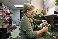Teresa Ripple, a floral designer at the Springdale Flower Shop, puts together and arrangement of sweetheart roses Wednesday, February 12, 2020, for a Valentines delivery at the florist shop in Springdale. Owner Rusty Eldridge said that roses and lilies remain the favorite for Valentine's Day. Check out nwaonline.com/200213Daily/ and nwadg.com/photos for a photo gallery.<br /> (NWA Democrat-Gazette/David Gottschalk)
