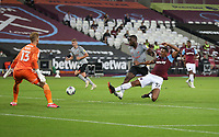 West Ham United's Sebastien Haller fails to get on the end of a cross under pressure from Charlton Athletic's Adedeji Oshilaja<br /> <br /> Photographer Rob Newell/CameraSport<br /> <br /> Carabao Cup Second Round Northern Section - West Ham United v Charlton Athletic - Tuesday 15th September 2020 - London Stadium - London <br />  <br /> World Copyright © 2020 CameraSport. All rights reserved. 43 Linden Ave. Countesthorpe. Leicester. England. LE8 5PG - Tel: +44 (0) 116 277 4147 - admin@camerasport.com - www.camerasport.com