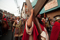People in the slum  El Nazareno in Petare, Eastern Caracas, re-enact the Stations of the Cross of Jesus Christ on Good Friday, the main celebration of Easter in Venezuela