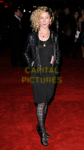 "BETH ROWLEY.At The Times BFI 53rd London Film Festival Gala Screening of ""An Education"" at the Vue West End, Leicester Square, London, England, UK, October 20th 2009..full length black leather jacket dress lacy patterned pattern tights lace-up shoes sandals hands in pockets tongue mouth funny .CAP/CAN.©Can Nguyen/Capital Pictures."