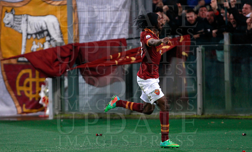 Calcio, quarti di finale di Coppa Italia: Roma vs Juventus. Roma, stadio Olimpico, 21 gennaio 2014.<br /> AS Roma forward Gervinho, of Ivory Coast, celebrates after scoring the winning goal during the Italian Cup round of eight final football match between AS Roma and Juventus, at Rome's Olympic stadium, 21 January 2014.<br /> UPDATE IMAGES PRESS/Isabella Bonotto