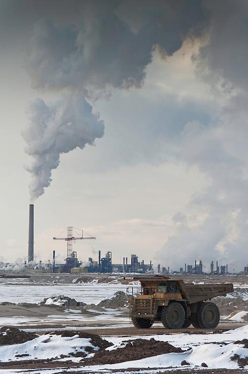 Tar Sands, March 2010. Syncrude and dumptrucks. Alberta Oil Sands, Tar sands, syncrude upgrader. Alberta Athabasca Tar Sands or Oil Sands.