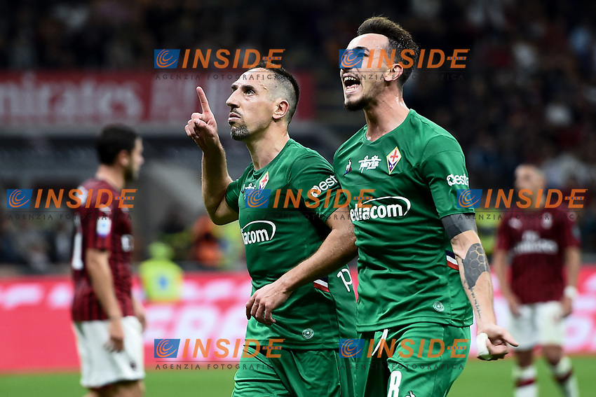Franck Ribery of Fiorentina celebrates with Gaetano Castrovilli after scoring the goal of 0-3 <br /> Milano 29/09/2019 Stadio Giuseppe Meazza <br /> Football Serie A 2019/2020 <br /> AC Milan - ACF Fiorentina   <br /> Photo Image Sport / Insidefoto