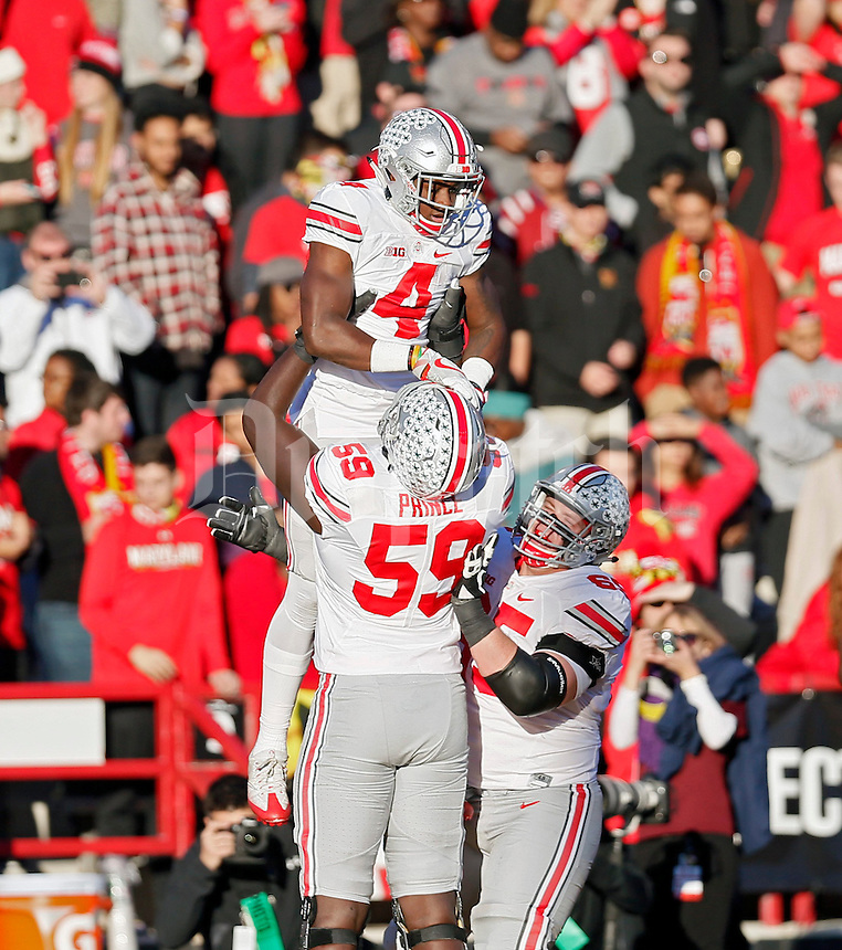 Ohio State Buckeyes running back Curtis Samuel (4) celebrates a touchdown catch with offensive lineman Isaiah Prince (59) during the 1st half at Maryland Stadium in College Park, Md. on November 12, 2016.  (Kyle Robertson / The Columbus Dispatch)