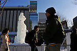 February 5th, 2013 : Sapporo, Japan - People walked pass an ice sculpture during the opening day of the Sapporo Yuki Matsuri, or Sapporo Snow Festival in Hokkaido, Japan. The Sapporo Snow Festival marks the 64th year consisting of various shapes and sizes of snow statues and ice sculptures. (Photo by Koichiro Suzuki/AFLO)