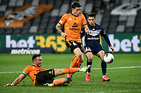 29th July 2020; Bankwest Stadium, Parramatta, New South Wales, Australia; A League Football, Melbourne Victory versus Brisbane Roar; Scott Neville of Brisbane Roar watches the clearance from Tom Aldred of Brisbane Roar as Luis Lawrie-Lattanzio of Melbourne Victory closes in