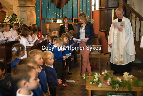 Charlton-on-Otmoor Oxfordshire May Day Celebrations. Children from the Church of England St Mary the Virgin Primary School process to the village church to have their May garlands blessed. The garlands are then hung on the church Rood Screen. May Garland Service then takes place. 2014.