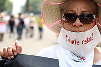 Mexico City, DF May 10, 2014. A woman carries a banner while people take part of a march demanding the government to search and locate their missing children. During the third National March for Dignity.  Miguel Angel Pantaleon/VIEWpress
