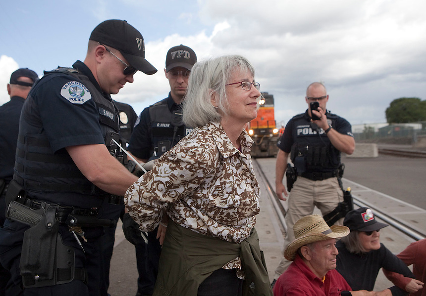 Linda Stovall is arrested as she takes part in a demonstration, blocking BNSF railroad tracks in Vancouver Saturday June 18 2016. (Photo by Natalie Behring for the Columbian)