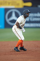 Rodolfo Castro (7) of the Greensboro Grasshoppers takes his lead off of second base against the Hagerstown Suns at First National Bank Field on April 6, 2019 in Greensboro, North Carolina. The Suns defeated the Grasshoppers 6-5. (Brian Westerholt/Four Seam Images)