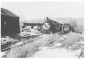 Front view of C-18 #318 in yards at Ridgway.  Roundhouse is in background.<br /> RGS  Ridgway, CO