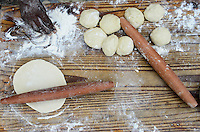 TANZANIA, table with flour and dough to make bread / TANSANIA Tisch mit Mehl und Teig zum Brot backen
